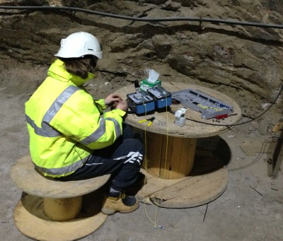 Optical fibre splicing and installation, deep mine environment.